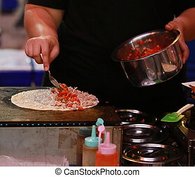 Hand cook Maxican food, plate with taco, tortilla chips and tomato dip