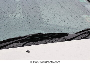 rain drops on car glass in rainy days, background
