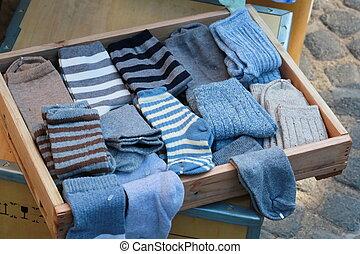 blue sock in wood tray - many blue sock in wood tray