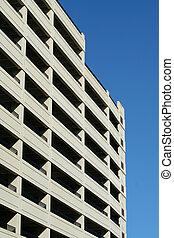 Parking deck - A tall parking deck against blue sky