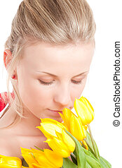 Young woman with bunch of tulips