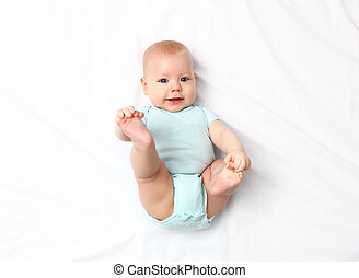 happy newborn baby on bed - happy newborn baby on the bed at...