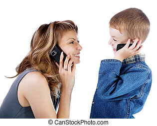 girl and boy talk by a cellular telephone
