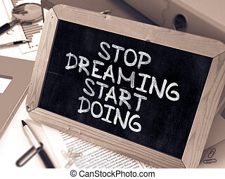 Stop Dreaming, Start Doing - Chalkboard with Hand Drawn Text.