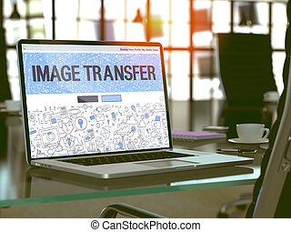 Image Transfer on Laptop in Modern Workplace Background. -...