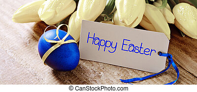 Happy Easter card and egg - Blue easter egg with tulip...