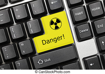 Conceptual keyboard - Danger yellow key with radiation...