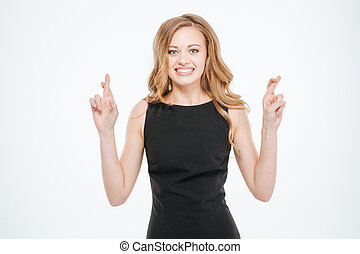 Woman standing with crossed fingers isolated on a white...