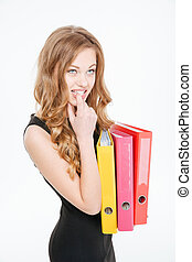 Pensive nervous pretty young businesswoman holding colorful...