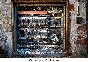 a detail of old broken circuit breakers