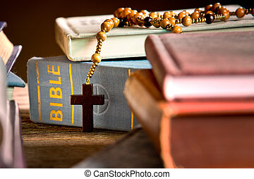 books, bible and rosary in the bookcase