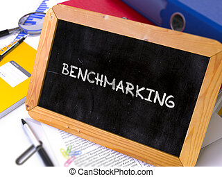 Hand Drawn Benchmarking Concept on Small Chalkboard - Hand...