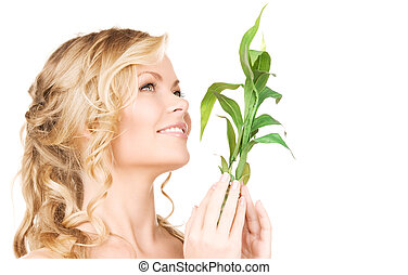 woman with bamboo - picture of woman with bamboo over white