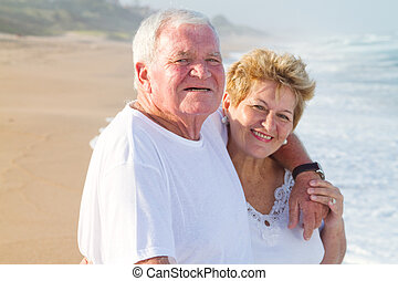 loving senior couple on beach
