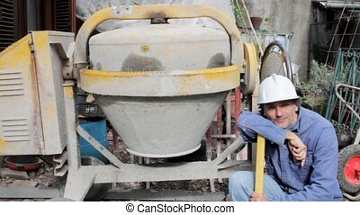 construction worker with cement mixer