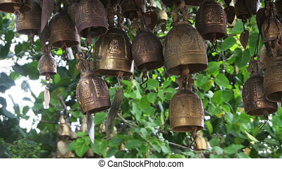 Wind Bells - Small bronse buddhist bell, that is swaying by...