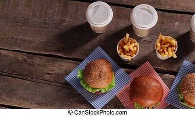Hamburgers with fries on table. Top view of fast food. New...