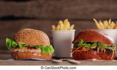Tasty hamburgers and french fries.