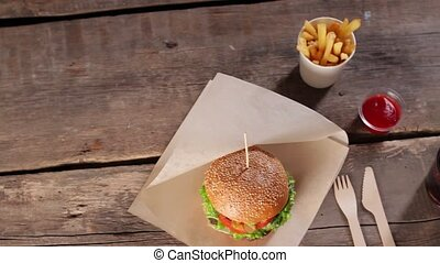 Burger with knife and fork. Fast food dinner with sauce....