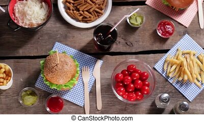 Potato chips with fresh burgers Tomatoes and chips on table...