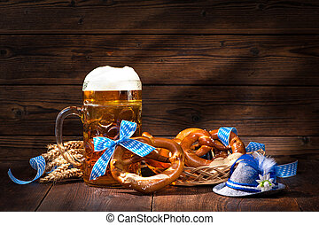 Original bavarian pretzels with beer stein on wooden board....
