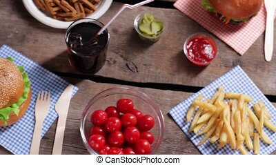 Hamburger with different sauces. Sauces and cup of fries....
