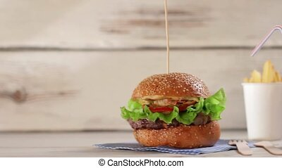 Burger with glass of cola Hamburger menu on white table...