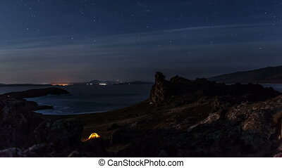 Moving stars above tent at night time lapse Mooving camera,...