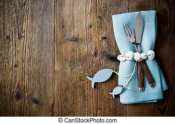 Fish cutlery tied with empty fish shaped tag