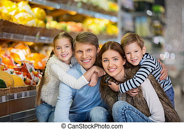 Family with kids - Smiling family in a store