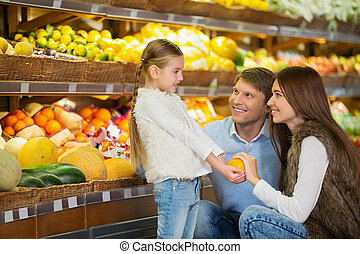 Groceries - Family with daughter indoors