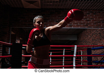 Strenght - Young woman with boxing gloves