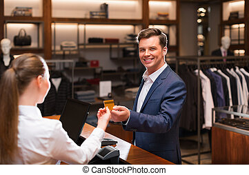 Man and cashier - Smiling man in suit in shop