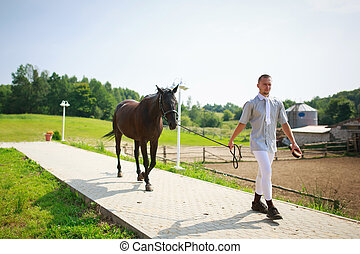 Stableman with horse