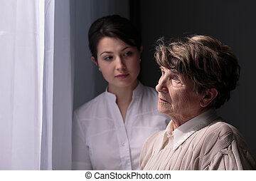 Waiting for relatives - Sad older woman in nursing home...