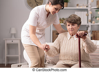 Woman standing up - Senior disabled woman standing up with...