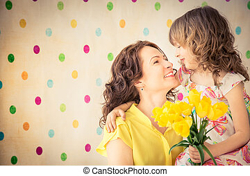 Mother's day concept - Woman and child with bouquet of...