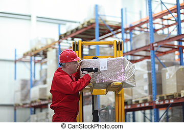 worker with bar code reader