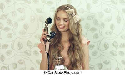 Girl talking on vintage phone - Laughing girl with curls...