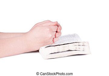 Hands praying person on the Bible