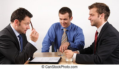 before signing contract - Three businessmen handling...