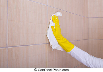 Woman cleaning bathroom tiles - Close up of female hand...