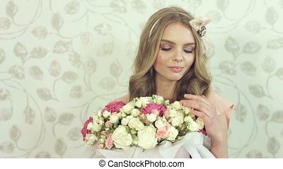 Gentle young woman with beautiful big bouquet at...