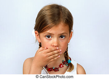 Little girl with hand over her mouth