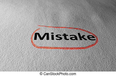 Mistake circled in red - Closeup of Mistake text on paper...