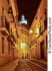 Alfama quarter at night in Lisbon, Portugal