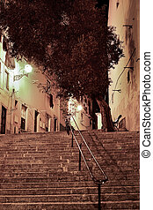 Alfama street at night in Lisbon, Portugal