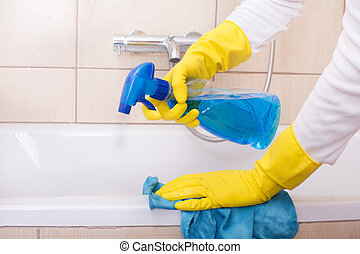 Woman cleaning bathtub - Close up of female hands with...
