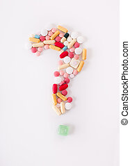 Question mark of pills - Different colorful pills shaped in...