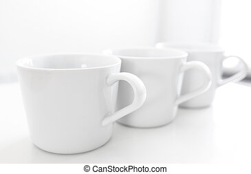 Cups on kitchen table